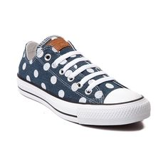 Don't be spotted without the Lo Dots Sneaker from Converse! Flaunt your spots with these Lo-top Chucks, featuring a polka-dot printed denim upper with leather logo patch and signature Chuck Taylor cap-toe. Only available at Journeys and SHI by Journeys!     Features include   Low top style constructed with a sturdy denim upper with breathable lining   Lace-up closure for a secure fit   Signature Chucks rubber cap toe offers protection and durability   Converse rubber outsole provides flexibl...