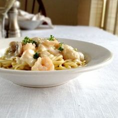 Creamy Seafood and Mushrooms over L