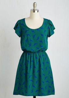 Dino My Gosh Dress in Pine. Its hard not to express the delight you feel when youre wearing the dark blue dinosaurs adorning this printed dress! #green #modcloth