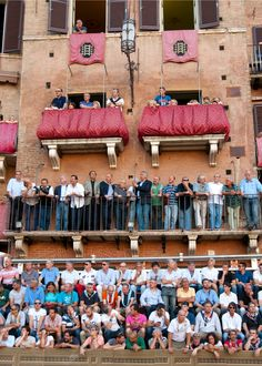 crowds and supporters fill every balcony at Il Palio Di Siena