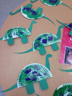 Dinosaurs made from paper plates and paint are easy and fun to create!