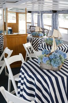 Charming navy blue and white stripes paired with sailboat centerpieces