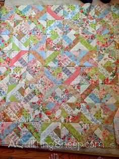 Jelly Roll Quilt and Paying it Forward ~ by A Quilting Sheep