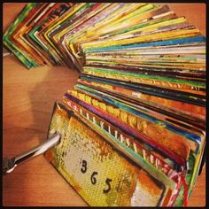 365 day pages on a ring - small art means you can create everyday. . . Made by Gretchen Miller, who is a registered art therapist. See her site for more inspiration . . .   http://gretchenmiller.wordpress.com/category/365-project/