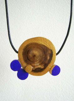 Wooden jewelry by Ioana Avram, via Behance