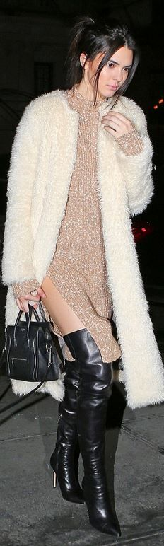 Kendall Jenner's white coat, tan dress, black thigh high boots, and black leather handbag fashion style id