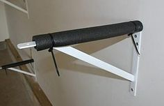 Kayak storage: This a heavy-duty shelf bracket screwed into the wall stud. It is covered with water pipe insulation and held on with plastic zip-ties.