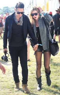 June 25, 2010 | Kate Moss with Jamie Hince at the Glastonbury Festival
