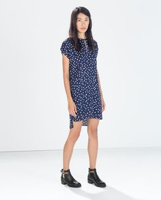Super cute pattern and shape.  Great transitional dress between seasons.  Love the blue with black booties.