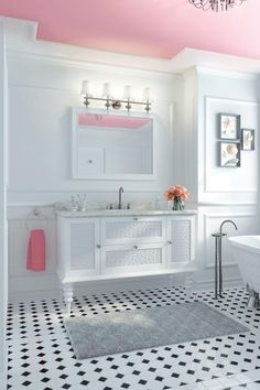 I love how the celing is pink and the rest of the room is white on white with minimal color accents and this is my dream bathroom floor tile!!!!