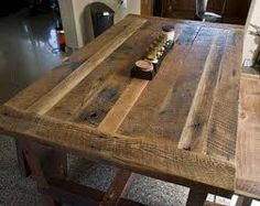 Looking for dining room table to put on a large porch using reclaimed barn wood.  This may work!