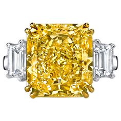 Burdeen's Breathtaking Fancy Yellow Radiant Cut Diamond Platinum Ring | From a unique collection of vintage three-stone rings at https://www.1stdibs.com/jewelry/rings/three-stone-rings/