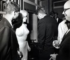 "Just hours after Monroe sang her sultry rendition of ""Happy Birthday"" to then president Kennedy at Madison Square Garden, the film star attended a private party with the commander-in-chief where White House photographer Cecil Stoughton snapped this shot, taken May 19, 1962 at the home of Arthur & Matilda Krim. Bobby Kennedy is chatting with Monroe & the president. Harry Belafonte & his wife are in the background."