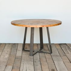 Table with pedestal base in reclaimed wood and steel legs in your choice of color, size and finish