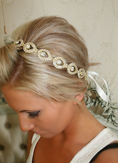 Rhinestones in the shape of teardrops give this gold hair piece ($48) its unique look. The ribbon also comes in customizable colors. // Affordable Bridal Hair Accessories