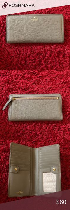 Kate Spade Wallet Authentic Kate Spade gray Stacy wallet. Like new! Lots of pockets for cards, button closure & large zipper pocket on back for coins. kate spade Bags Wallets