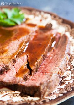 Classic roast beef recipe using rump roast, round roast, or sirloin tip.  This slow roasting method at low heat is good for tougher cuts of beef; the lower heat prevents any gristle from getting too tough. On SimplyRecipes.com