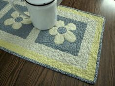 Daisy patchwork table runner by granniesraggedybags on Etsy, $25.00