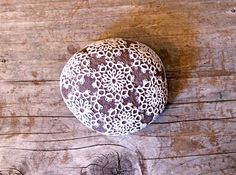 tatting-lace covered stone from etsy