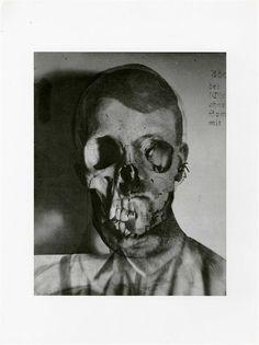 Erwin Blumenfeld (German-American, 1897-1969). Portrait of Hitler and a Skull [superimposition]. Original photogravure. 1932.