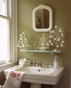 Adorable Christmas Decorating Ideas Bathroom With Framed Mirror And White Pedestal Sink Listed In 40 Amazing Christmas Bathroom Decorating Ideas