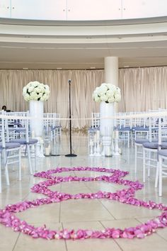 Wedding ceremony aisle treatment: Hexagon outline out of rose petals at Segerstrom Concert Hall, photo by Jules Bianchi