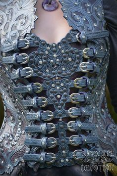 Front: Fully hand carved leather corset armor by Absolute Devotion https://www.facebook.com/pages/Absolute-Devotion/10099221406
