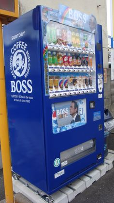 """Japanese Vending Machines :) """"Coffee Boss"""" with what looks like Tommy Lee Jones on the front."""