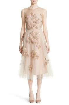 Free shipping and returns on Carolina Herrera Sequin Leaf Tulle Midi Dress at Nordstrom.com. Glossy beads and shimmering sequins trace a delicate leaf motif down an enchanting party dress that begins with ethereal illusion yokes and finishes with a lightly flared midi skirt of two-tone layered tulle.