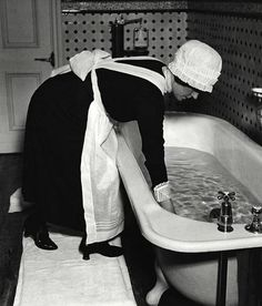 Maid getting the bath ready.