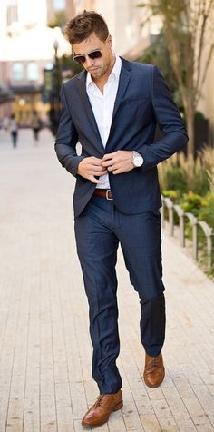 Preparing for a meeting, try to look great to achieve the best result. A blue suit with brown shoes are the best combination. #stylish #fashionable #elegant #business