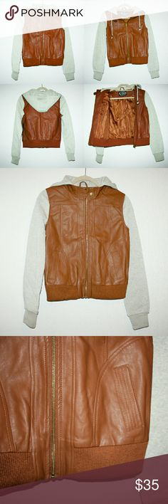 Bomber Jacket Hoodie - Vegan Leather & Fleece NWOT I love this stylish and versatile lightweight hooded bomber jacket! It would look great with skinny jeans and heeled booties. The vegan leather is soft and a cognac brown color. The sleeves and hood are a fleece 'oatmeal' color sweatshirt material that is soft on your skin. Faux leather: 100% polyurethane, sleeves & hood: 100% polyester. Medium tag but fits smaller, so I listed as small. Jackets & Coats