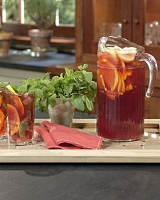 Red Iced Tea:  6 cups water  4 Red Zinger tea bags  4 Raspberry Zinger tea bags  1 orange, sliced 1/4 inch thick  1 lemon, sliced 1/4 inch thick  Sprigs fresh mint, for garnish  Ice