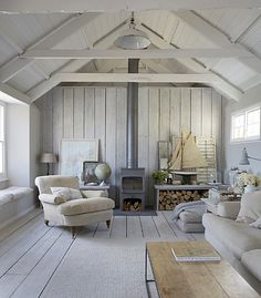 Simplicity in a guest cottage. A-frame roofline makes this scene so striking.