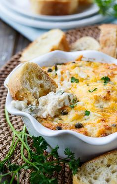 Incredible Hot Crab Dip made with crab meat, cream cheese, mayo, horseradish, capers, and cheddar cheese.