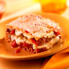 Classic Lasagna: Hearty layers of flavorful meat, cheese and seasoned tomato sauce between al dente lasagna noodles baked to bubbling perfection