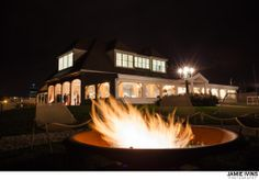 The Island House at Belle Mer at night from the fire pit