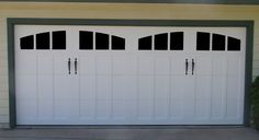 The white steel garage door with the indented column design is a nice contrast to the horizontal paneling of the home. The jet black hardware door handles of the door are a delicate and beautiful addition to the modern home.