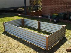 uncapped raised bed, from wood and corrugated tin panels, see link
