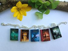 Percy Jackson and The Olympians series, book charm bracelet...another think that I could probably make. Maybe modge podge and image of the book covers onto plastic squares...