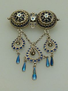 A city type solje brooch made of silver & enamel by famous jewelry Norwegian designer Marius Hammer