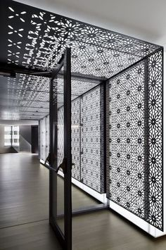 Love this/KAUST Offices | Studios Architecture | Photo: Bilyana Dimitrova | Archinect Black and white. Laser cut screen. Backlit decorative pattern. Wall and ceiling entrance. Minimal.