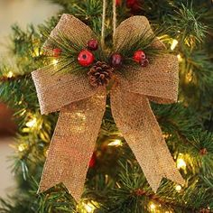 SEE HOW TO MAKE YOUR OWN  AT http://acrosstheblvd.blogspot.com/2014/09/burlap-bow-ornament.html  @Gloria Fann  This looks like something that would go great with your tree decor and I'm pretty sure it would be easy to make. Natural Burlap Bow
