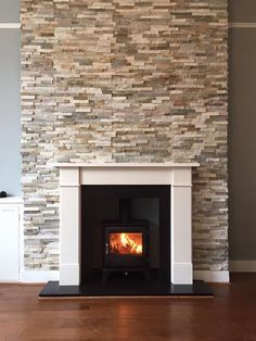 """Wood burning stove installation with limestone surround - Chesneys Salisbury 5kw wood burning stove - Capital Fireplaces Hersham 54"""" Limestone surround"""