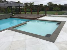 Harkaway Bluestone pool coping tile paired with white quartzite premium pool tiles #wowfactor #bluestone #pool #summerready