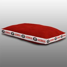 Let your furry friend sleep in style and show off their team spirit with their very own Georgia Bulldogs Dog Bed by Sports Coverage. Your pet will love taking naps after playtime or sleeping at night