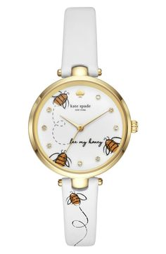 kate spade holland bee leather strap watch. Buzzing bees flit across the crstyal-studded dial of a polished goldtone watch set on a supple leather strap.