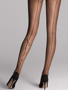 """An elegant seam runs the center of the back leg, giving them that seductive touch. The ultimate eye-catching embellishment, the cursive words """"love is enough"""" are written along the length of the leg. Gorgeous for both day and night.  Sheer, matte tights  Wide grip edge at hem for durability  Pleasantly soft knitted waist  Also available in XL  Also available as stay-ups"""