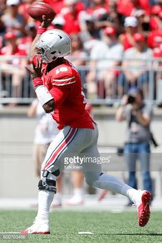 News Photo : J.T. Barrett of the Ohio State Buckeyes throws a...