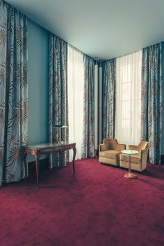 Blue bedroom hotel suite design with Art Deco curtains and rich red carpet - Art Deco inspired designs of the Hotel Saint Marc luxury boutique hotel in central Paris, France. Retro Interior Design inspiration and images from the hotel featured on the Martyn White Designs Blog